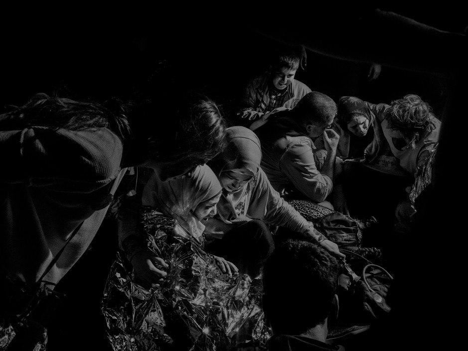 Alex Majoli. Refugees and migrants from Syria, Afghanistan, Pakistan, Somalia arrive on the northern shores of Lesbos after their journey from the Turkish coast, Greece, 2015.